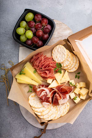 Cheese and meat assortment in a to go box 版權商用圖片