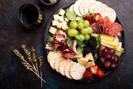 Cheese platter on dark background Imagens