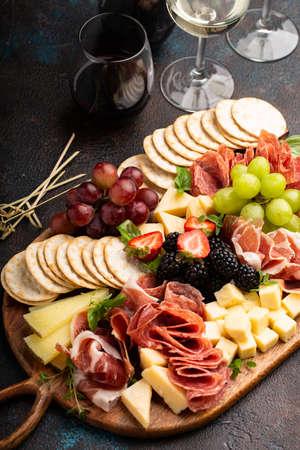 Cheese board on dark background