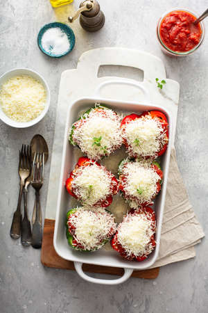 Stuffed peppers with marinara sauce and ground beef