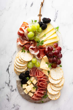 Charcuterie board with variety of cheese and meat Standard-Bild
