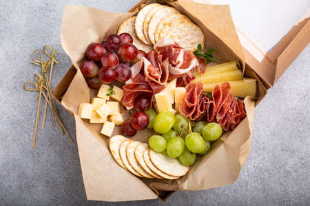 Charcuterie board in a box with cheese and meat Standard-Bild