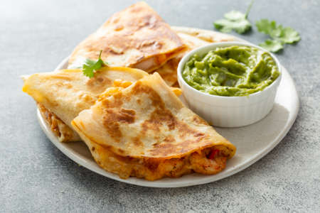 Shrimp and cheese quesadillas served with guacamole