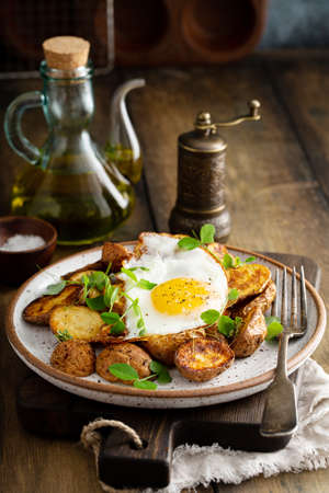 Air fried new potatoes topped with egg
