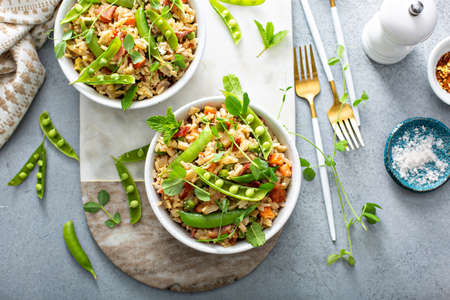 Breakfast fried rice with bacon and peas Standard-Bild