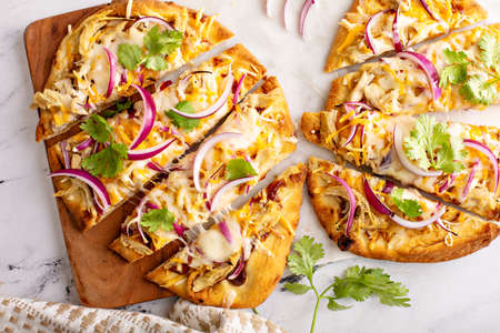 Barbecue chicken flatbreads with hot sauce and red onion