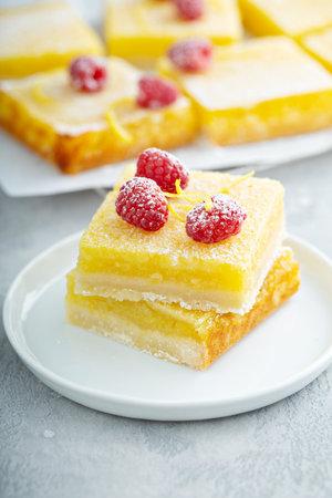 Lemon pie squares topped with rasperries, homemade dessert