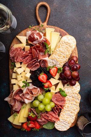 Cheese or charcuterie board on dark background