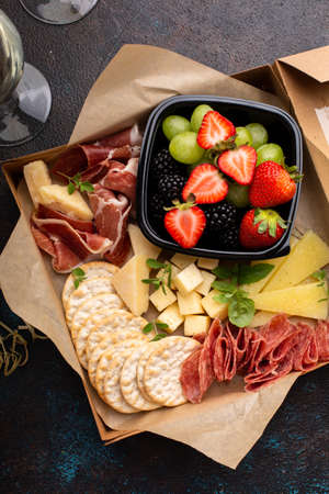 Cheese and meat assortment in a to go box Standard-Bild