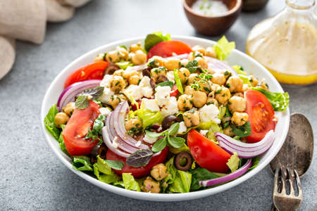 Healthy spring Greek salad with fresh vegetables and chickpeas Reklamní fotografie