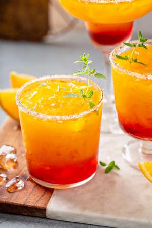 Tequila sunrise margarita cocktail with ice, refreshing drink 版權商用圖片