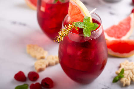Raspberry grapefruit refreshing cocktail with mint leaves