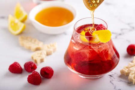 Raspberry, honey and lemon cocktail or mocktail