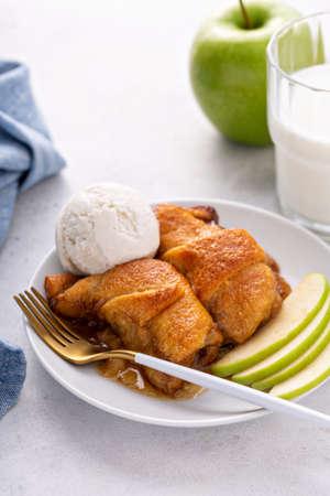 Apple dumplings in flaky pastry with caramel sauce 版權商用圖片