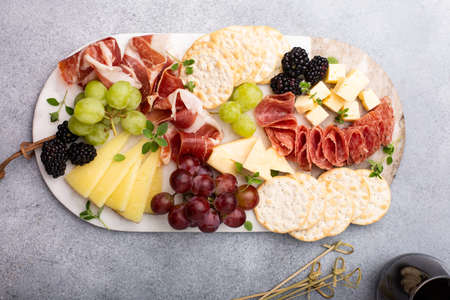 Summer charcuterie board with cheese, meat and fruit 版權商用圖片