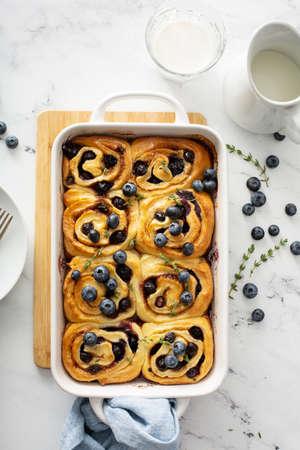 Summer breakfast idea, blueberry cinnamon rolls in a baking dish