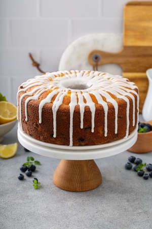 Lemon blueberry pound cake with powder sugar glaze Фото со стока