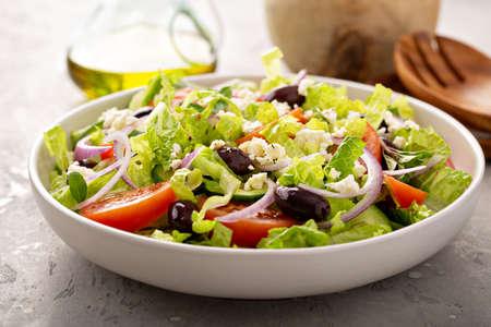 Fresh vegetables and feta greek salad with homemade dressing