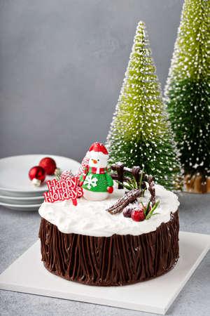 Chocolate Christmas celebration cake with holiday decorations