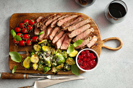 Holiday steak and brussel sprouts for Christmas Фото со стока