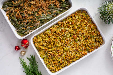 Christmas dinner side dishes including greean beans casserole and stuffing Фото со стока