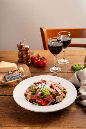 Antipasto salad with salami, artichoke hearts and vegetables