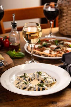 Seafood and cheese ravioli with creamy sauce and fresh basil