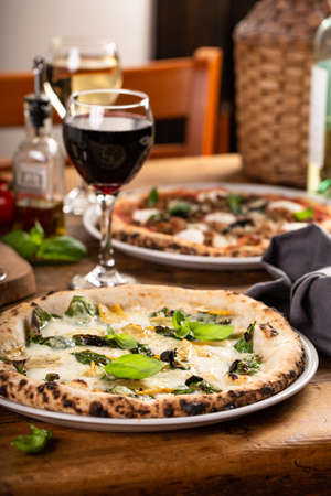 Pizza Napolitana or Naples style with cheese, mushrooms and basil