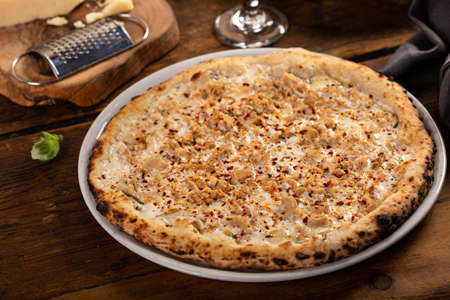 Cheese, clams and chili flakes pizza, freshly baked