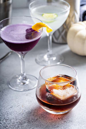 Fall cocktails, old fashioned in a glass with ice cube