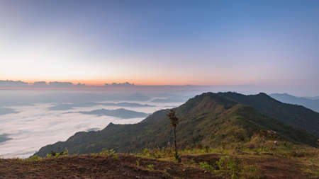 unseen: Beautiful Sunrise of travel place with morning mist at Phu chi duen Unseen in Chiangrai,Thailand