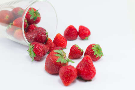 Fresh strawberries isolated in clear glass
