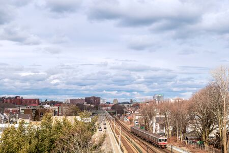View of railway tracks, trains and downtown in the distance in Quincy, Massachusetts