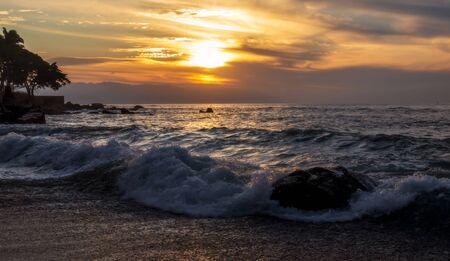 Sunset at the rocky beach - Puerto Vallarta, Jalisco, Mexico. 版權商用圖片