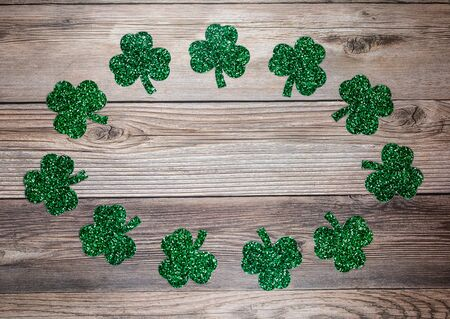 Flat lay composition with clover leaves on wooden background. Saint Patrick's day