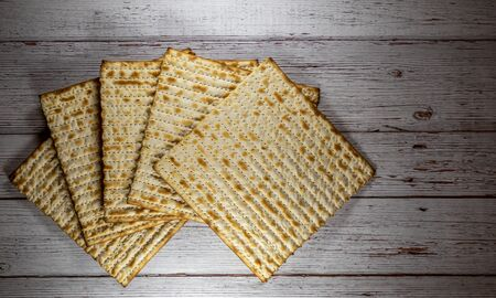 Passover matzos on the natural wooden background