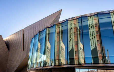 Reconstruction of Denver Art Museum in Denver, Colorado, architectural detail. New glass building with beautiful reflections located between the sharp