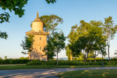Beautiful view of the historic water tower in  Harkness Memorial State Park, Connecticut, USA, on sunset
