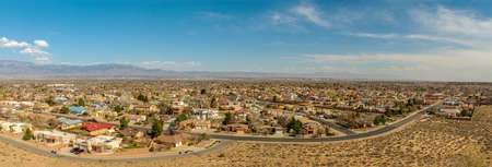 Southwest living. Albuquerque Metro Area Residential Panorama with the view of the Sandia Mountains in the distance. Petroglyph National Monument, New Mexico