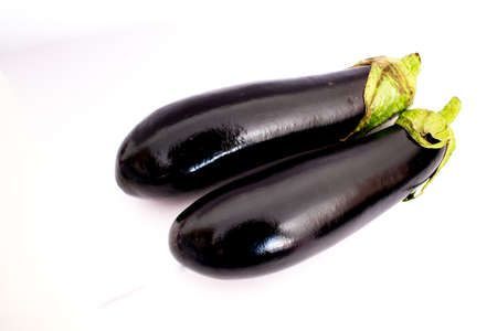 dieta: Aubergine composition in white background Stock Photo