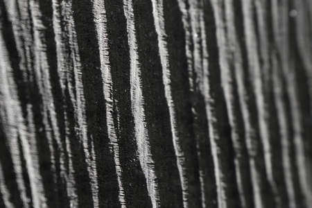 Wooden texture in black and white with light and shadows effects