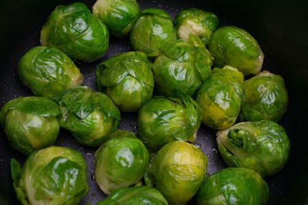 Many cooked Brussells sprouts close up background
