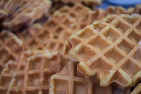 A group of waffles bacground disposed in a bakery Stock Photo