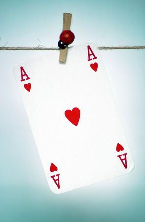 vehemence: Heart ace hanging on a rope, blue background
