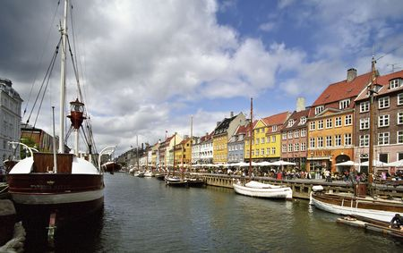 Colorful houses in Copenhagen with a boat photo