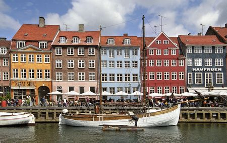 Colorful houses in Copenhagen wit a lot of tourists photo