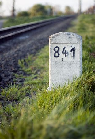 kilometre: Railway milestone number 841 in the grass