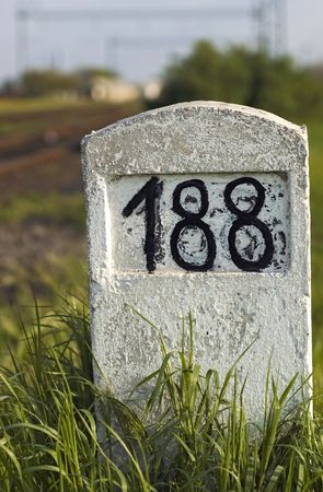 kilometre: Old milestone in the grass