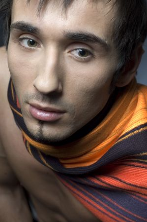 Young fashion male model with athletic body posing in colorful srarf Stock Photo - 4610624