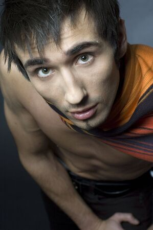 Young fashion male model with athletic body posing in colorful srarf Stock Photo - 4610655